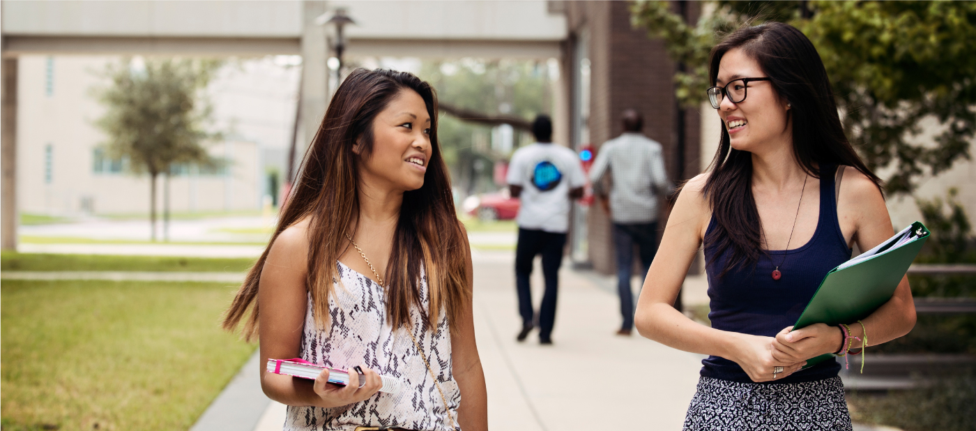Two Female Students Walking on the University of Houston Campus
